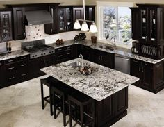 (paid link) No element transforms a kitchen quite next the color of its cabinets. ... If you have brown flooring, dark brown and red cabinets perform particularly ... #kitchencabinets Dark Brown Kitchen Cabinets, Black Kitchen Countertops, Kitchen Craft Cabinets, Brown Kitchens, Kitchen Cabinet Design, Dark Cabinets, Kitchen Black, Kitchen Backsplash, Dark Counters