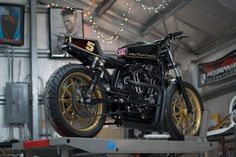 The Player: DP Customs' radical 1200 Sportster looks magnificent in the classic JPS racing livery.