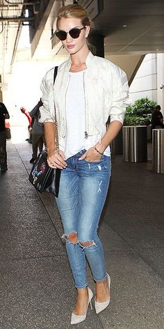 Rosie Huntington-Whiteley in ripped jeans, heels, and a white bomber jacket