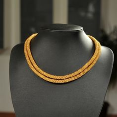 Unique handmade long gold bead necklace made of gold beads and white thread.