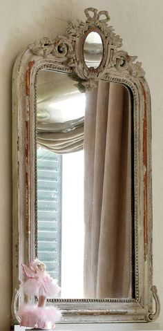 Mirror :)  I HAVE A LOT OF MIRRORS - THEY ARE GOOD FENG SHUI AND CREATE SPACE AND LIGHT
