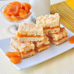 Apricot Coconut Crumble Bars - a buttery coconut crumble surrounds a simple apricot compote in these delicious freezer friendly cookie bars.