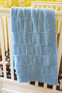 This blanket's basketweave pattern creates a beautiful checkerboard texture. (Lion Brand Yarn)