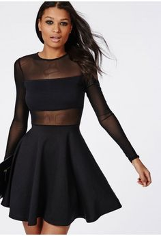 Take on two of the hottest trends of the season in one with this striking skater dress with mesh long sleeve and smokin' panel detailing. With a flared skater skirt to enhance curves, this mini is cheeky and subdued at the same time, perf...