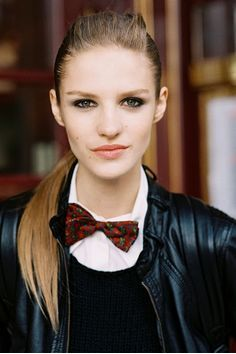 It's the feminine hairstyle that keeps the leather and novelty bowtie looking fresh