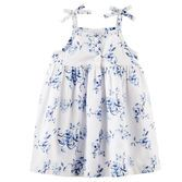 With pretty porcelain flowers, this dress is super sweet for her first day of summer.<br>