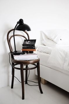 Thonet chair as a bedside table. Dumpster diving and inorganic week rummaging to find these kinds of things.