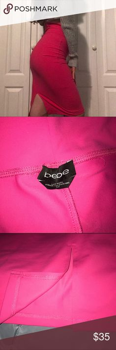 💕BEBE💕 Hot Pink Bodycon Skirt Bebe hot pink bodycon skirt in a size small. NWOT. 5 inch slit up the back. bebe Skirts Midi