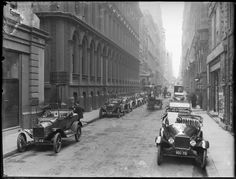Looking down Flinders Lane, horse drawn vehicles on road, cars lining curbs, pedestrians on paths. If you'd like to find out more about this image, or download a hi-res copy, visit our catalogue: handle.slv.vic.gov.au/10381/73966