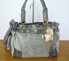 grey juicy purse    Details :          1. All bags come with dust bag , and top quality .          2. All bags are 100% brand new .
