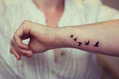 birds arm tattoo