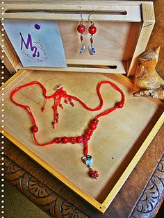 """RED BERRIES Necklace - Hearts Collection -  Murrina heart glass pendant,big wood red  pearls alternate to red """"raspberry """" beads : all on red  cotton  strings closed with a button and red  pendants .   RED BERRIES Earrings  -  Murrina heart glass pendant, big wood red  pearls ."""