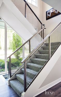 Contemporary White Staircase with Patterned Runner