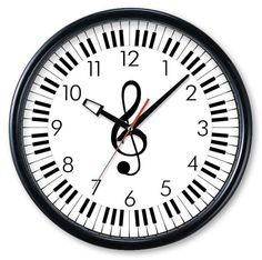 $29.95 G-Clef Keyboard Wall Clock.  Great for the studio!