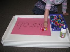 Invitation to play - Making a name collage with pompoms. Learning4kids