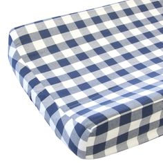 Our Brett's Navy Gingham changing pad cover features a classic navy gingham pattern that fits in a baby boys nursery easily. This adorable changing pad cover will be sure to bring smiles to any changi