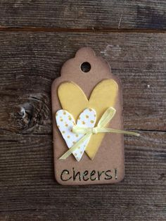 Cheers! Cute tag. Stacked primitive hearts on crumb. Stickles on sentiment. --NineMonthsLove design.