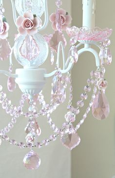 """dress any room with loads of sparkle, romance and charm. Perfect for a nursery, little girls bedroom, or breakfast nook. <BR><BR> • Cottage White<BR> • Handmade to order<BR> • Ready to hang<BR> • Detailed glass neck<BR> • Glass bobeches<BR> • Drip-candle covers<BR> • 13""""W x 20""""L<BR> • Comes with matching ceiling cap and 39"""" of chain"""