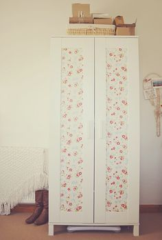 my ikea wardrobe - the panels used to be a sort of see-through grey, so I bought some cath kidston wallpaper to cover them up!