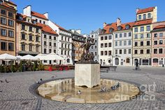 Old Town Square in Warsaw, Poland, houses and The Mermaid Statue called Syrenka, historic city center rebuild after the World War II