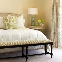 Warm whites and cool greens make a soothing sleeping environment! More white bedroom ideas: http://www.bhg.com/rooms/bedroom/color-scheme/white-bedrooms/?socsrc=bhgpin061814warmingtrend&page=5