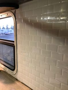 RV back splash. Faux subway tile peel-and-stick back splash for the camper or RV. So cute! Really brightens up the RV.