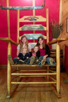 In a giant rocking chair at Cock of the Walk restaurant in Nashville, Tennessee