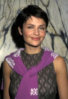 Pin for Later: 150+ Supersexy Moments to Get You Excited For the VS Fashion Show  Helena Christensen wore a lace top and a pixie cut backstage in 1997.
