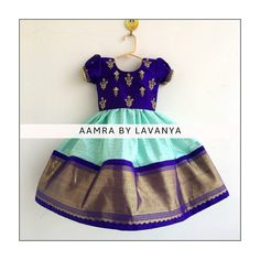 Stunning sea green and blue color combination kids pattu lehenga and blue color top. Kids parikini with floral design hand embroidery gold thread work.  For details and color customisations please call/whatsapp on +91-9177363970. 11 February 2019