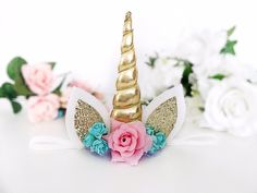 Our beautiful unicorn headband is the perfect accessory for any magical unicorn! Made from a metallic gold horn and beautiful fabric flowers and securely set on
