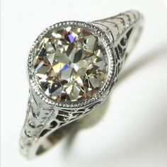 Oh My!: This swoon worthy ring has the dreamiest antique diamond, held in a smooth bezel and supported by magnificent hand pierced filigree. Ca.1920. Maloys.com