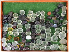 Large lot of glass gem seals