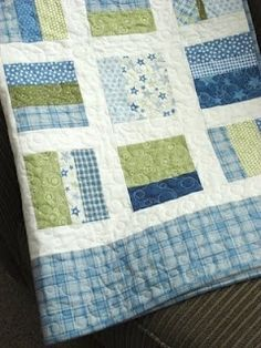 Baby quilt.. Simple pattern but effective execution because of artful use of…