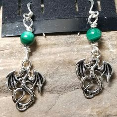 Silver dragon earrings with malachite beads.