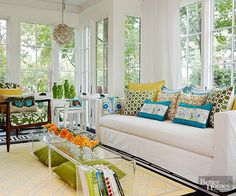 Update with Quick-Change Pattern- To add visual interest and texture, the homeowner relied on a diverse collection of similarly hued colors and patterns, including a Greek key motif, floral patterns, and an eclectic chandelier. BHG