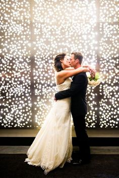 twinkling lights backdrop with formal elegant black and white wedding ideas. (but still fun) :)