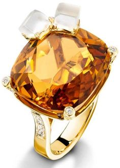 Piaget whiskey on the rocks ring.  Via Diamonds in the Library.