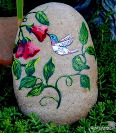 hummingbirds, handpainted rocks,art,garden decor...very sweet! I love all the natural Rock that is exposed!!