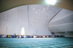 (Previous post continuation) A look inside Education City's glittering new mosque in the Qatar Faculty of Islamic Studies. The mosque, a large white cavernous structure with Quranic verses embossed. Mosque Architecture, Religious Architecture, Architecture Design, Education City, Islamic Studies, Beautiful Mosques, Space Interiors, Prayer Room, Doha