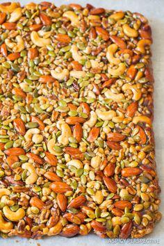 Amazing Paleo Nut Bar Recipe with Chocolate Drizzle on ASpicyPerspective.com #paleo #vegan #glutenfree