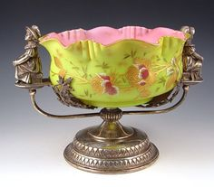 VICTORIAN ART GLASS BRIDES BASKET UNUSUAL CHARTREUSE GLASS BOWL CASED IN PINK, GILT AND ENAMEL FLORAL DECORATION. RUFFLE RIM. THE HOLDER WITH  KATE GREENWAY  TYPE FIGURES BY WILCOX SILVERPLATE CO.