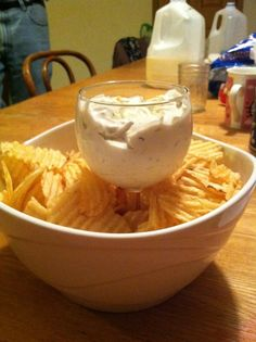 good idea for a chip/dip set. put a wine glass filled with dip in the center of a bowl and fill with chips. Also works with a margarita glass with tortilla chips and salsa.