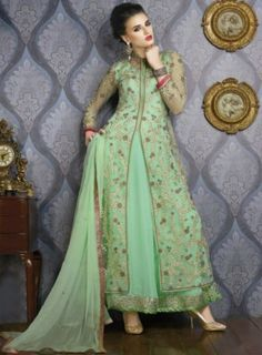 Amazing Aquamarine #PistaGreen Net #Lehenga Style #Anarkali #Suit Features A Heavy Embroidery Green Net Top With Hand Work,Heavy Sleeves Alongside With Georgette Lehenga With Daman Lace Chiffon Dupatta Complete The Look.