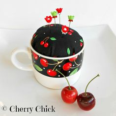 Mary Engelbreit Cherry fabric pincushion with Decorative Sewing Pins