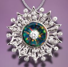 Dramatic black lab-grown opal and diamond pendant from Galatea's Illusia Collection. 14k white gold setting. Style A18.