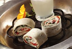Flour tortillas rolled up with picante-seasoned cream cheese, fresh spinach, roasted red peppers and turkey breast make flavorful pinwheel appetizers.