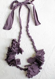 "Violet Garland Fabric Necklace 28.99 Floral garland necklace in a deep violet fabric. Wear as a necklace, belt, headband, or any way you like!, ,  19"" long (adjustable).  shopruche.com"