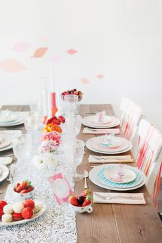 love the ribbons on the chairs, the many flower colors...and the linen napkins!