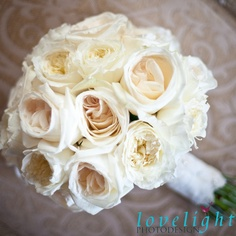 Pale pink and ivory and cream roses fill out this bridal bouquet for a vintage chic and romantic feel