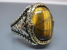 Stone/Stones= Tiger's Eye. Material= 925 Sterling Silver. Ring Face(mm)= 20x15. Coating= Yellow Part is Bronze. Ring Size(US)=10. Stamboul Jewelry. Resizing (For Free)= 10 to 14(US). Weight(gr)= 13,5.   eBay!